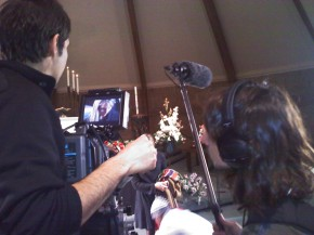 Video camera with operator, audio tech with boom pole